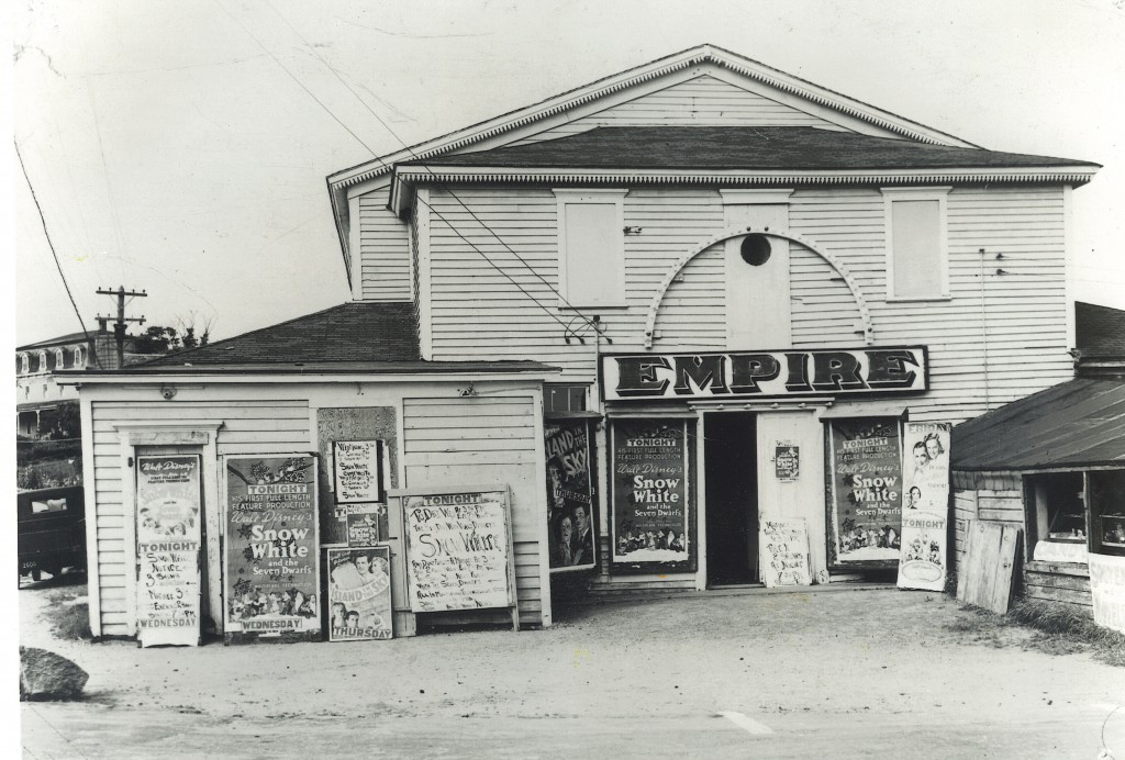One of the few American industries that expanded in the Depression was the film industry that produced movies that helped Americans dream. This shot shows the Empire Theatre advertising Snow White, one of Disney's contributions to animated film history.