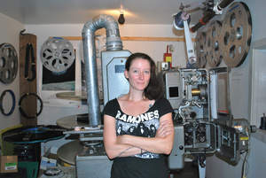 Photo by: Kari Curtis Leah Welch stands by the Empire Theatre's 35mm projector.